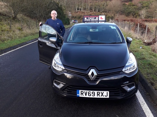 David Anderson standing by his Renault Clio